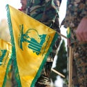 Hezbollah members hold flags marking Resistance and Liberation Day, in Kfar Kila near the border with Israel, southern Lebanon in May.