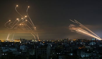 Iron Dome interceptor missiles (R) and rockets fired from Gaza (L) during May's fighting between Israel and Gaza