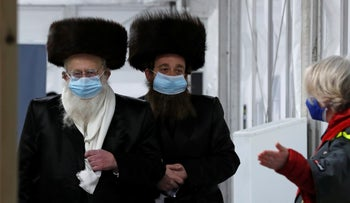 Two ultra-Orthodox men arrive at an event to encourage vaccination among the U.K.'s Jewish community, in London, February. The subjects of this photo have no connection with the content of this article.