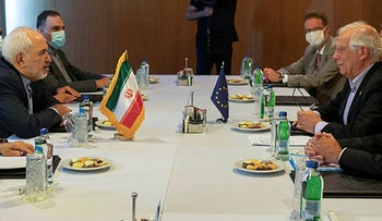 Heading their respective delegations, Josep Borell, second right, European Union's High Representative for Foreign Affairs and Security Policy, Iran's Foreign Minister Javad Zarif, second left, meet on the sidelines of a diplomatic forum in Antalya, Turkey, Friday, June 18, 2021