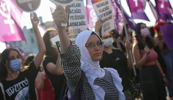 Women hold placards as they participate in a protest against the government's decision to withdraw from Istanbul Convention, in Istanbul, earlier this month