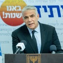Foreign Minister Yair Lapid speaking at a party press conference earlier this month.