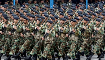 Iranian soldiers march during a military parade as they mark the country's annual army day in Tehran, on April 18, 2019.