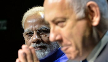 Indian Prime Minister Narendra Modi and former Israeli Prime Minister Benjamin Netanyahu in Israel in 2017. Over 1,000 Indian numbers were potentially targeted by NSO's Pegasus software