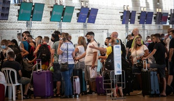 Outgoing travelers at Israel's Ben-Gurion Airport, on Sunday.