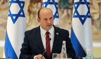Prime Minister Naftali Bennett chairs the weekly cabinet meeting at the Knesset in Jerusalem on July 19, 2021.