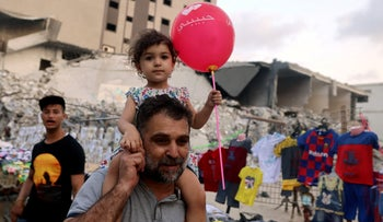 A father and daughter at a Gaza market celebrating the Eid al-Adha festival yesterday.