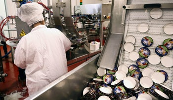 Lids of Ben & Jerry's ice-cream tubs are seen as a labourer works at their factory in Be'er Tuvia, Israel July 20, 2021