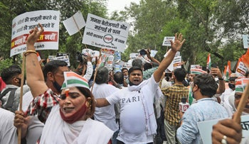 Congress party workers protesting the government's use of spyware to monitor political opponents and others, New Delhi, Tuesday.