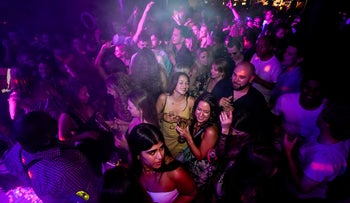 People drink on the dance floor shortly after the reopening, at The Piano Works in Farringdon, in London, this week
