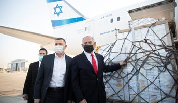 Benjamin Netanyahu and then-Health Minister Yuli Edelstein attend the arrival of a plane with a shipment of Pfizer vaccines, at Ben-Gurion International Airport in January.