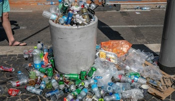 A trash can filled with plastic bottles and aluminum cans in Tel Aviv, last month.