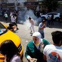 Demonstrators react to tear gas during clashes with Palestinian security forces in Ramallah, last month.