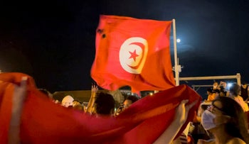 Crowds gather on the street after Tunisia's president suspended parliament, in La Marsa, near Tunis, on Monday.