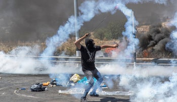 File photo: A Palestinian demonstrator in clashes with Israeli troops near Ramallah, in May.