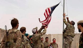 The U.S. flag was lowered as American and Afghan soldiers attended a handover ceremony from the U.S. Army to the Afghan National Army last May