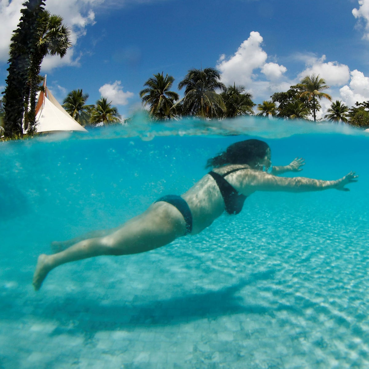A tourist from Israel enjoys in a swimming pool in Phuket, Thailand, this month.