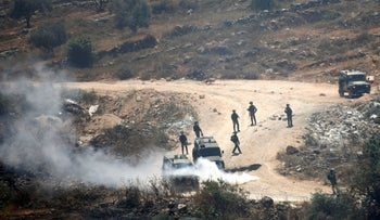 Members of Israeli forces are deployed during a Palestinian protest against Israeli settlements near Beita, in the West Bank June, 2021.