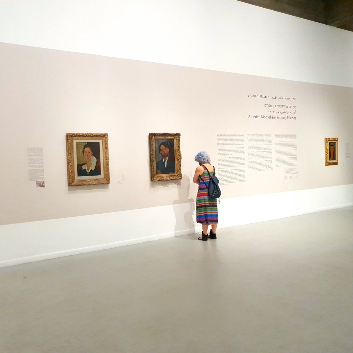 """Visitors attending the """"Amedeo Modigliani: Among Friends"""" exhibit at the Tel Aviv Museum of Art."""
