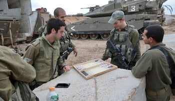 Israeli soldiers play backgammon near the Israel-Gaza border during the recent round of fighting between Israel and Hamas, two months ago.