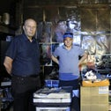Acre Theater director Moni Yosef and artistic director Khaled Abu-Ali examining the damage after the venue was torched in May.