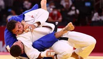 Israeli judoka Peter Paltchik in his bout against Shady El Nahas, in Tokyo, on Thursday.