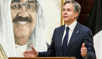 U.S. Secretary of State Antony Blinken speaks at a press conference in Kuwait City, Thursday, with a portrait of Kuwait's Crown Prince in the background.