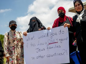 A protest in favor of the family reunification law. The crux of the debate is the very presence of the goy as a disruption in the Jewish state.