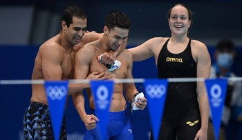 Israel's Anastasya Gorbenko (right), Itay Goldfaden (center) and Gal Cohen Groumi cheer after qualifying, at the Tokyo 2020 Olympic Games, on Thursday.