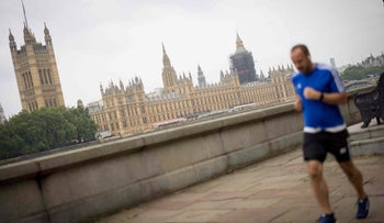 A man runs on the Thames Embankment with the Houses of Parliament in the background, in London this week.