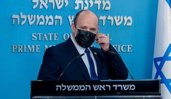 Naftali Bennett prepares to give a press conference, earlier this month.
