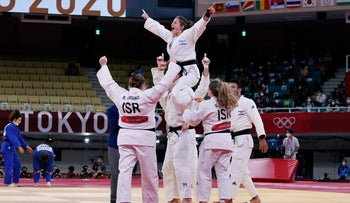 The Israeli judo team celebrating their bronze medal at Tokyo Olympics, today.