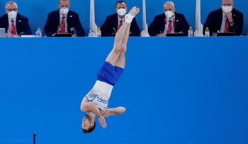 Artem Dolgopyat of Israel, performs on the floor exercise during the artistic gymnastics men's apparatus final at the 2020 Summer Olympics, today