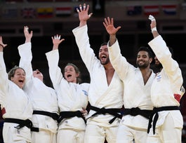 Team Israel celebrates winning the judo mixed team's bronze medal B bout against Russia during the Tokyo 2020 Olympic Games at the Nippon Budokan in Tokyo on July 31, 2021.