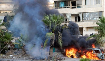 Flames engulf a vehicle following clashes in the Khalded area, south of Beirut, Sunday.