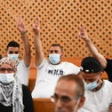 Sheikh Jarrah residents hold up the 'peace' sign in the Israeli High Court hearing, Monday