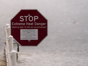An extreme heat warning sign in front of visitors walking through Death Valley National Park in California last month.