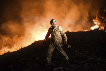 A firefighter trying to tackle a wildfire in Turkey recently.