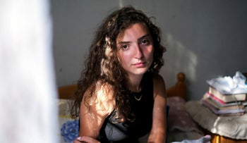 Tatiana Hasrouty, whose father was killed in last year's Beirut port blast, poses in her family home in Sin El Fil, Lebanon July 30, 2021.