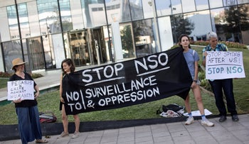 Protestors hold placards and a banner during a protest attended by about a dozen people outside the offices of the Israeli cyber firm NSO Group near Tel Aviv, last week.