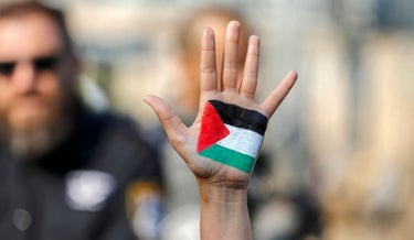 A pro-Palestinian protester with a flag painted on their hand during a demonstration in Sheikh Jarrah last week.