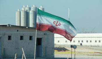 An Iranian flag flutters in Iran's Bushehr nuclear power plant, 2019.