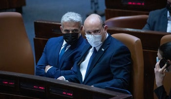 Prime Minister Naftali Bennett and Foreign Minister Yair Lapid in the Knesset, on Monday