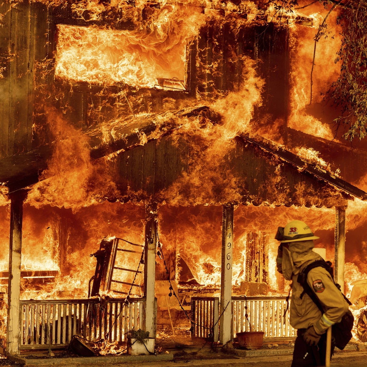 Fire consumes a home as the Sugar Fire, part of the Beckwourth Complex Fire, tears through Doyle, Calif., on Saturday, July 10, 2021