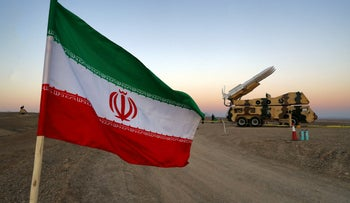 An Iranian flag is pictured near in a missile during a military drill, last year.