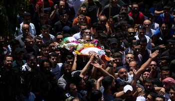 Palestinians carry the body of Mohammed al-Alami, 11, during his funeral in the village of Beit Ummar, in the West Bank, last week.