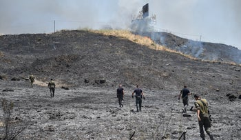 The hill where a rocket fired from Lebanon landed in Israel on Friday.