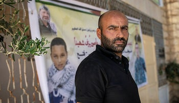 Mohammed al-Alami's standing in front of his picture