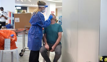 Man gets tested for COVIF-19 in Haifa, yesterday.