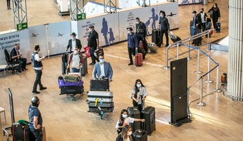Travelers head to get COVID-19 tests after arriving in Ben Gurion Airport in Lod, Israel, last week.